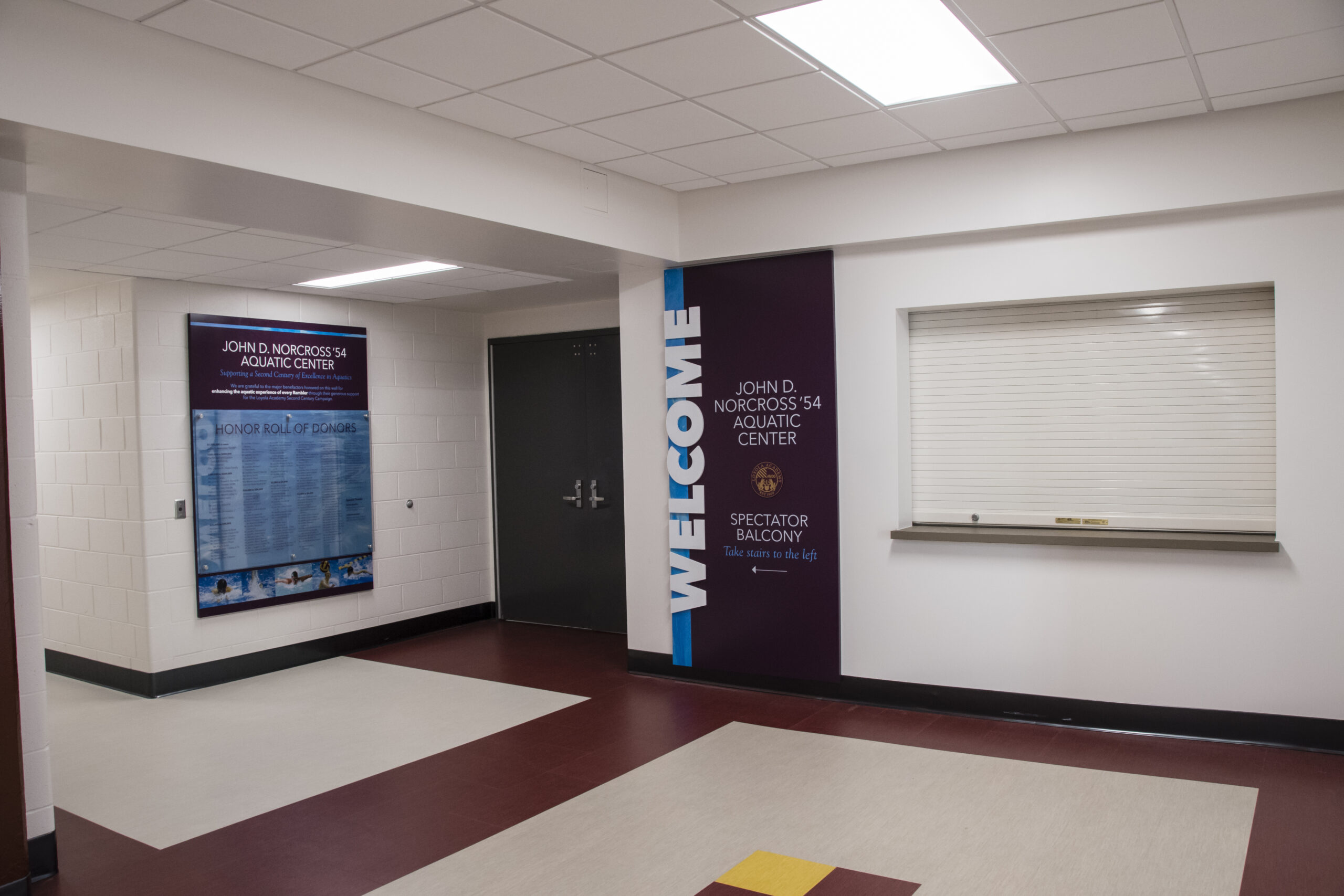 Interior hallway of Loyola Academy Aquatic Center.