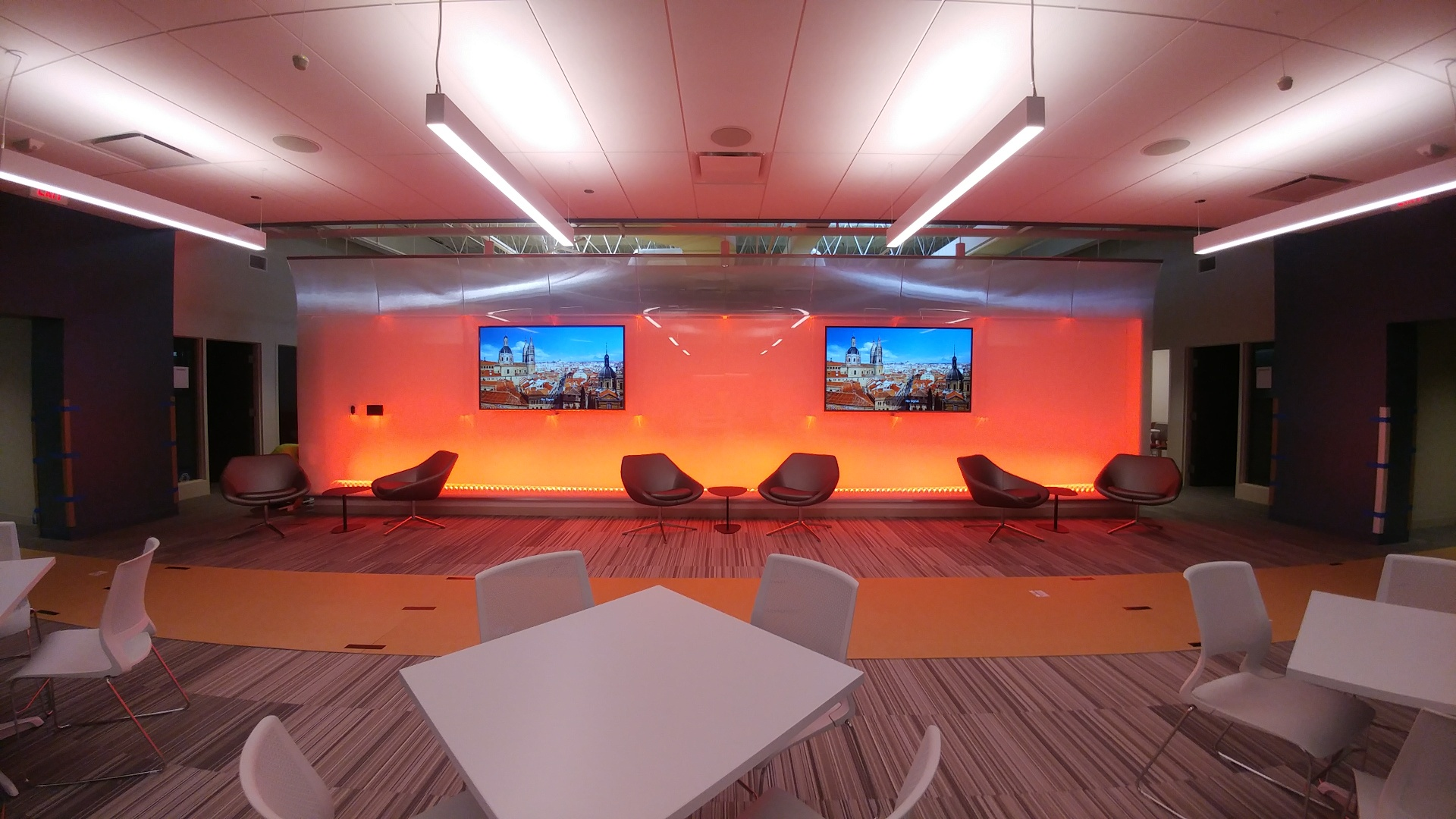 Sitting and collaboration area, with media screens, AANS.