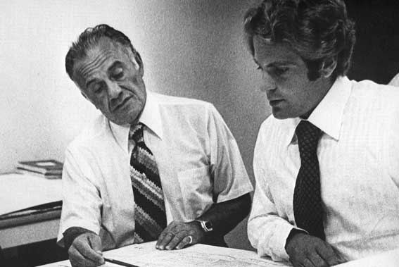 Historical photo of Valenti seniors, collaborating in office.